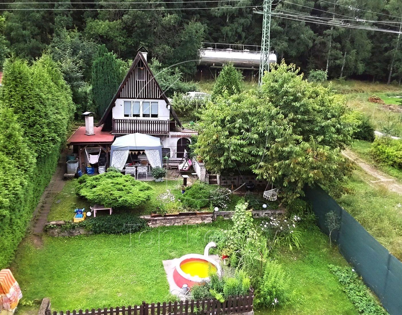 Prodej chaty se zahradou - Karlovy Vary, Doubí