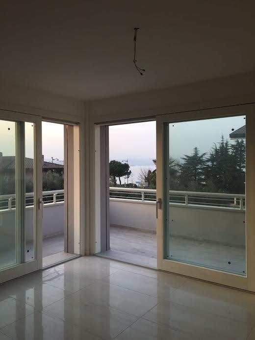 Velký byt se střešní terasou, Rivoltella del Garda