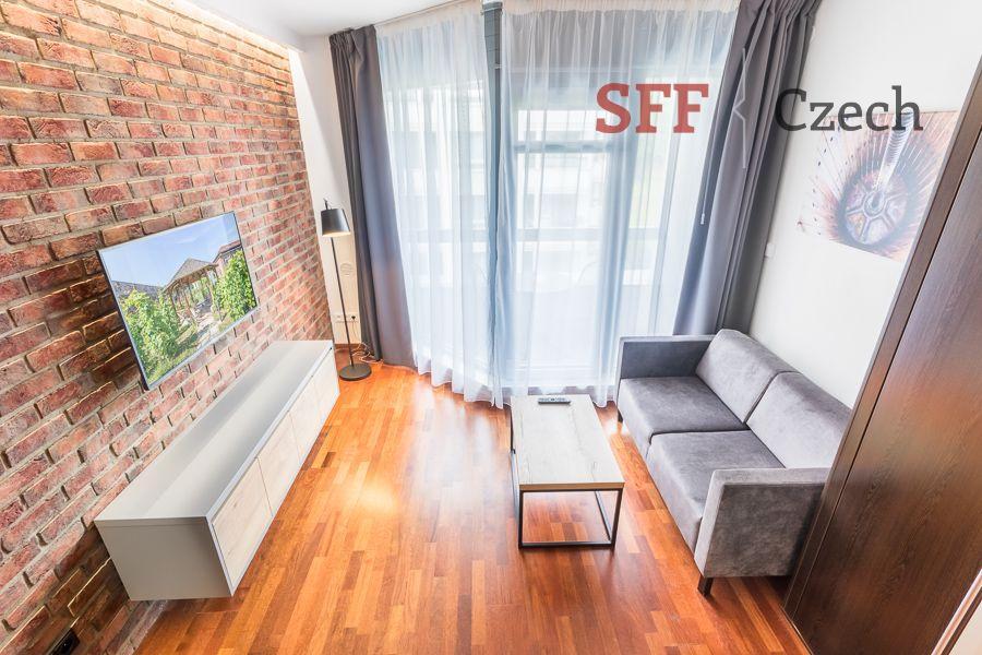 Velmi pěkný moderní vybavený byt 1+kk v rezidenci s recepci v širším centru Prahy